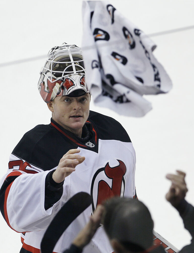 Goaltender Cory Schneider calls for a towel during the first period.