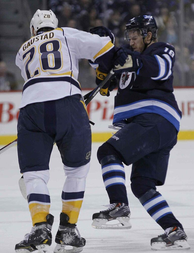 Winnipeg Jets' Bryan Little (18) gets checked by Nashville Predators' Paul Gaustad (28) during second period NHL action in Winnipeg. (John Woods / Winnipeg Free Press)