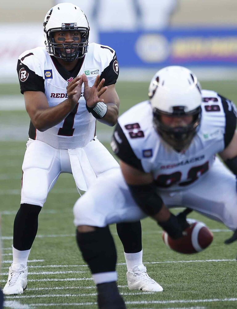 Ottawa Redblacks quarterback Henry Burris (1) calls for the ball deep in the Winnipeg Blue Bombers' zone during the first half of Thursday's game.