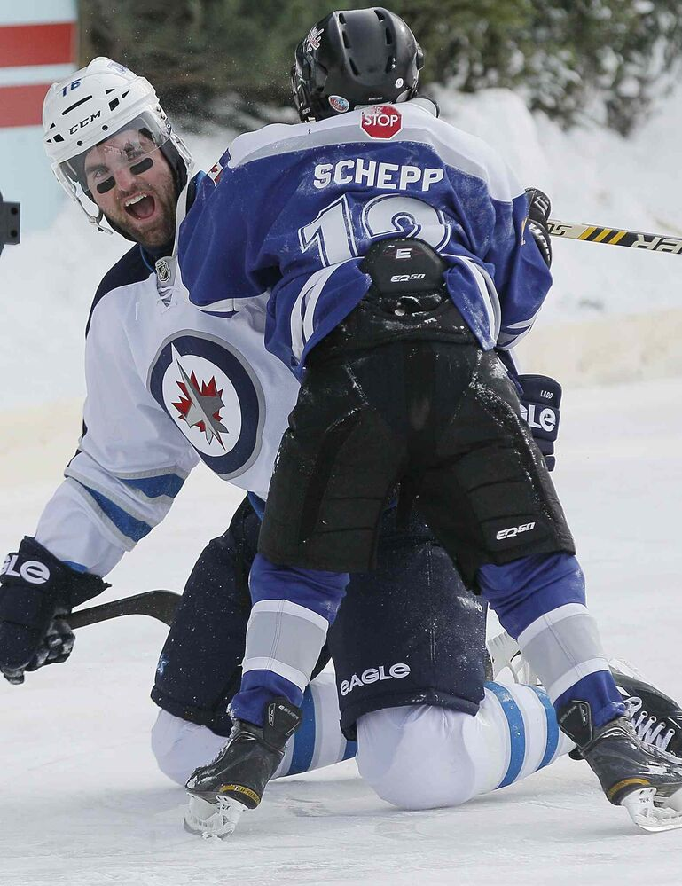 Jets captain Andrew Ladd (left gets roughed up by Carson Schepp of the Portage Atom A's as hundreds of fans came out to watch the Winnipeg Jets at an outdoor practice at The Forks on Sunday. (John Woods / Winnipeg Free Press)