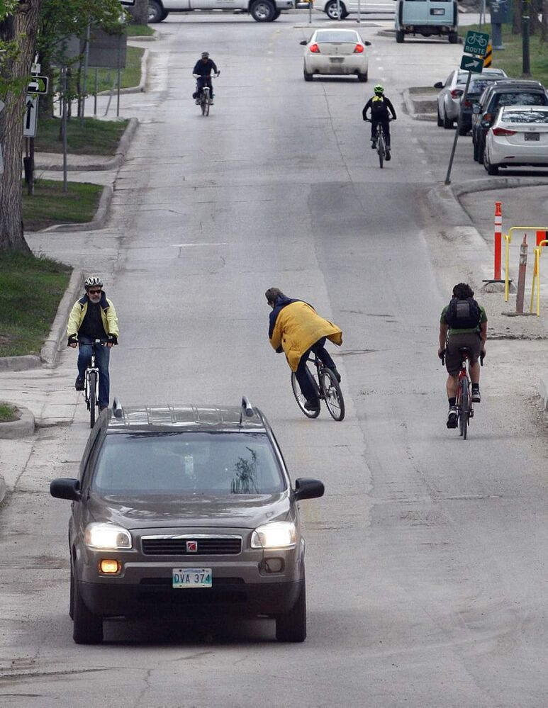 Cyclists outnumber cars on Assiniboine Avenue for a time as the morning rush hour begins.  May 28  2013 
