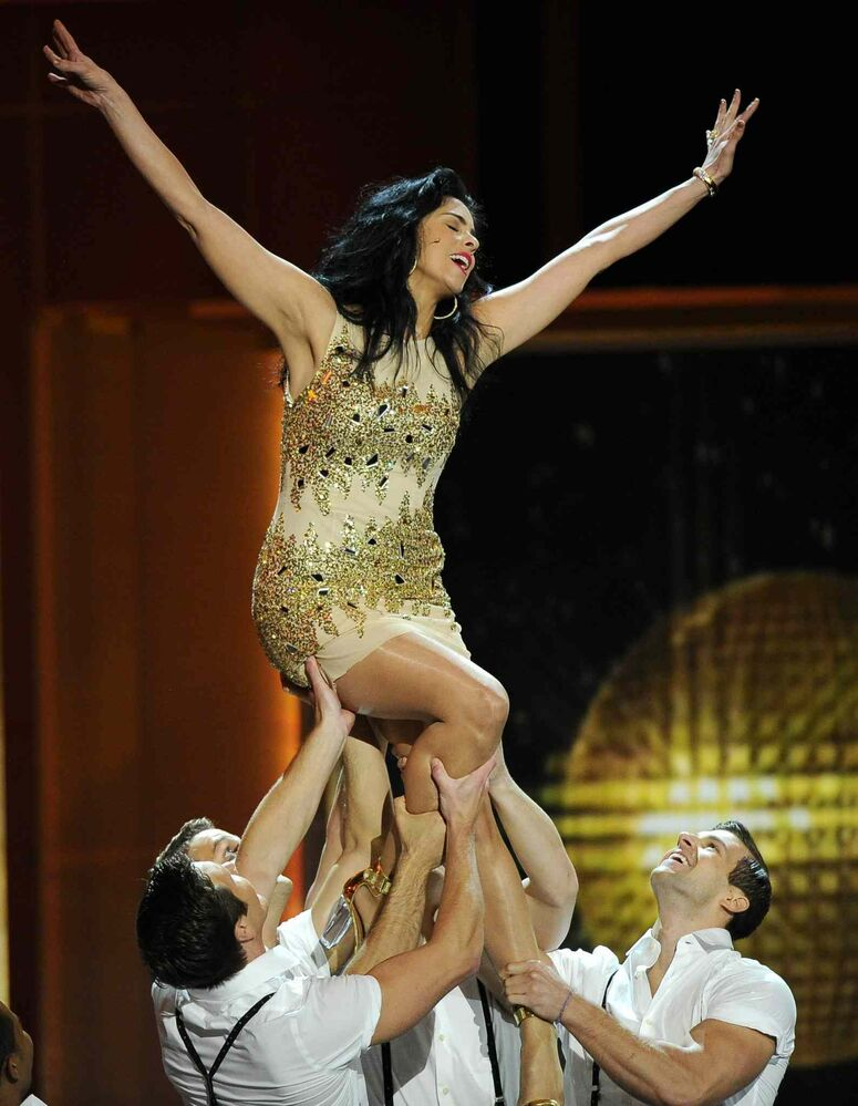 Sarah Silverman performs with dancers at the awards ceremony.