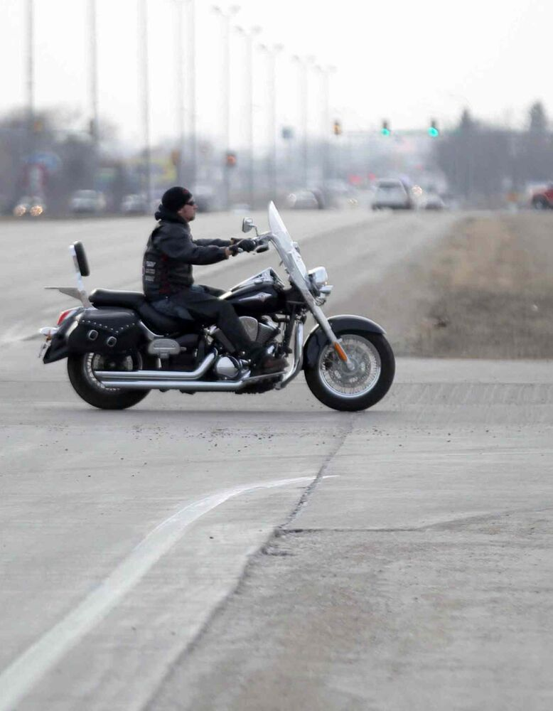A motorcyclist hits the road in Watertown, South Dakota.