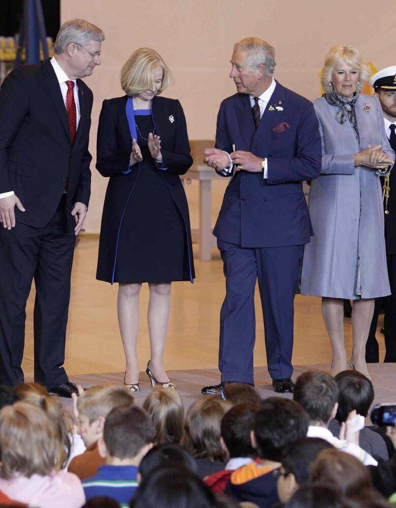 From left, Prime Minister Stephen Harper, his wife Laureen, Prince Charles and Camilla Duchess of Cornwall at the Stevenson Hangar ceremonies.    (Wayne Glowacki / Winnipeg Free Press )