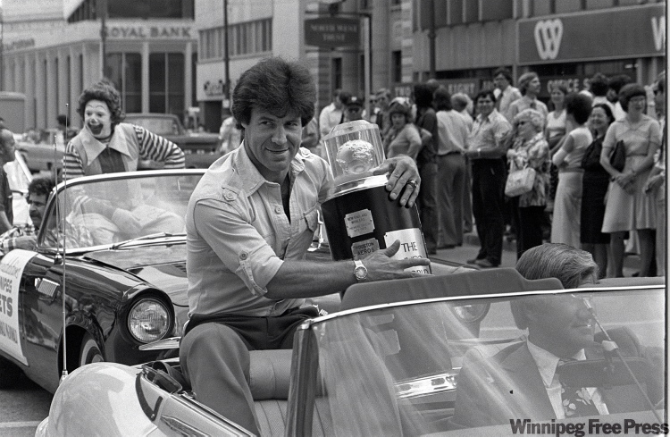 On May 23, 1978, Lars-Erik Sjoberg holds Avco Cup which was broken during celebration the night before.