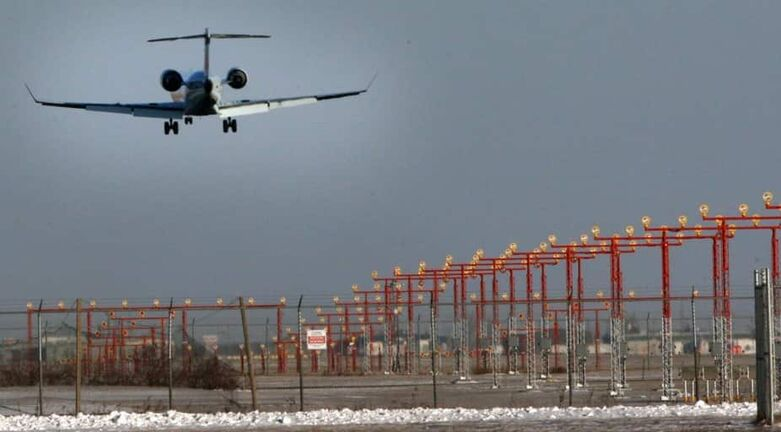 A aircraft on final approach to runway at James A Richardson International Airport in Winnipeg  Wednesday morning- See Bart's 49.8 – Nov 26, 2014   (JOE BRYKSA / WINNIPEG FREE PRESS)