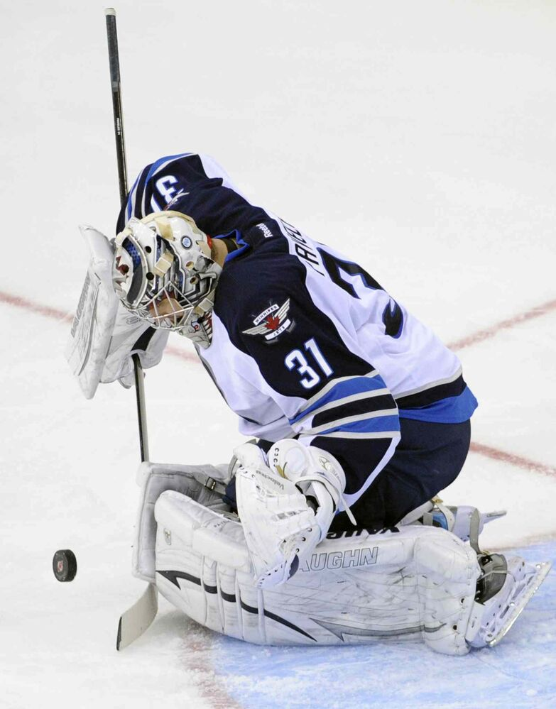 Winnipeg Jets goaltender Ondrej Pavelec makes a save during the third period of an NHL game against the New Jersey Devils in Newark, N.J., Monday. (BILL KOSTROUN / THE ASSOCIATED PRESS)