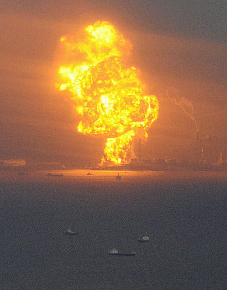 Flames rise from an oil refinery after a powerful earthquake in Ichihara, Chiba prefecture (state), Japan, Friday, March 11, 2011. The largest earthquake in Japan's recorded history slammed the eastern coast Friday. (AP Photo/Kyodo News)