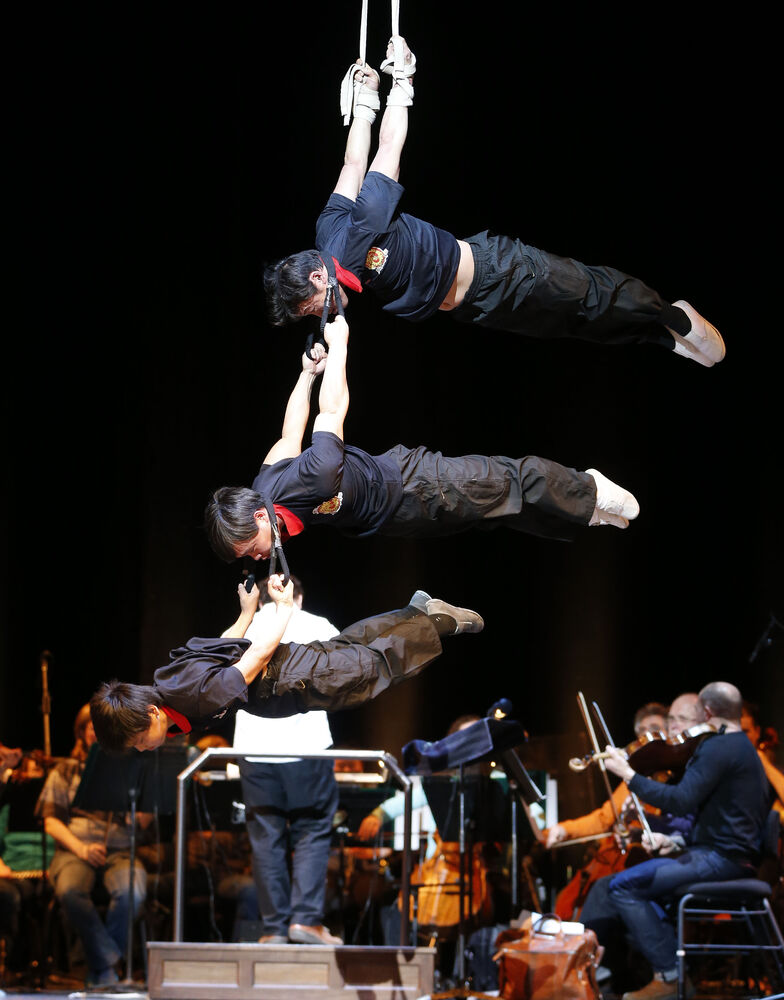 The Peking Acrobats balance in mid-air to the Winnipeg Symphony Orchestra's score before the first of three performances in Winnipeg this weekend.