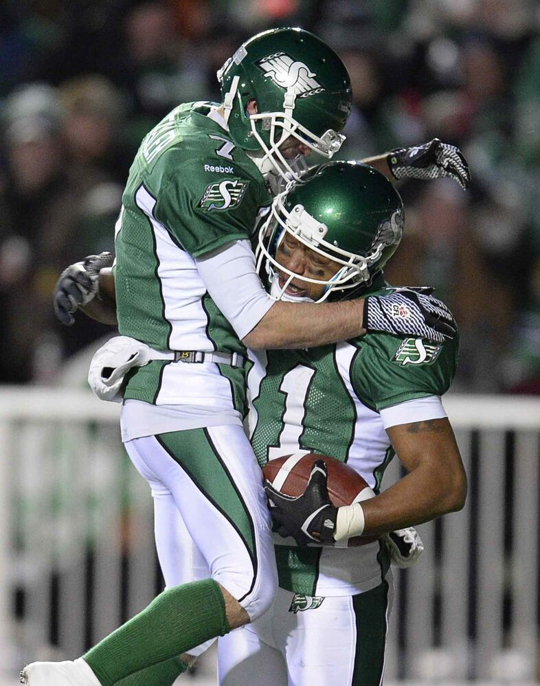 Saskatchewan Roughriders slotback Geroy Simon (right) celebrates his touchdown against the Hamilton Tiger-Cats with teammate Weston Dressler during the first quarter.