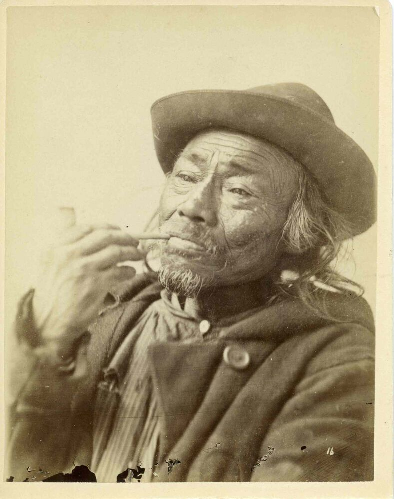 Portrait of an Indigenous man smoking a pipe    (UNIVERSITY OF MANITOBA ARCHIVES AND SPECIAL COLLECTIONS)