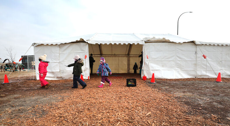 Kindergarten students from  Ecole Sage Creek take part in a gym class Tuesday inside a tent set up on the school grounds site as part of a pilot project. (Ruth Bonneville / Winnipeg Free Press)