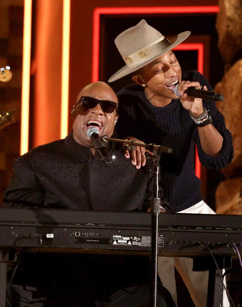 Stevie Wonder, left, and Pharrell Williams perform.