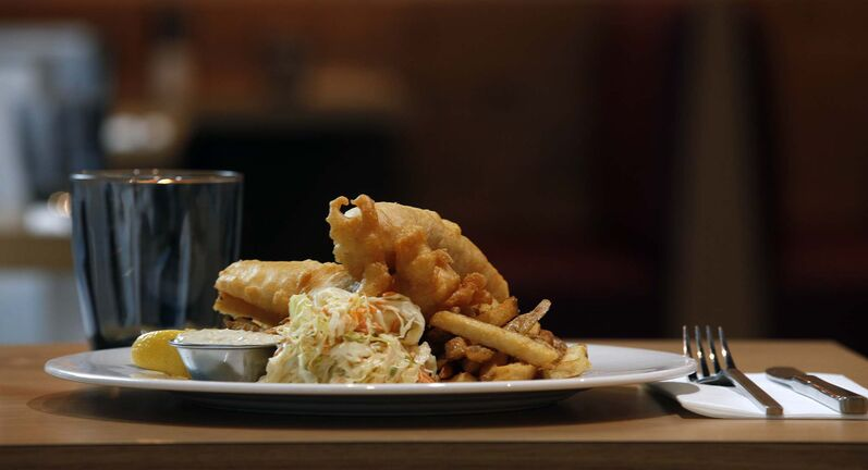 The fish and chips at the Capital Grill downtown are outstanding, offering crisp and light batter with none of that gluey undercoating. (Phil Hossack photos / Winnipeg Free Press)