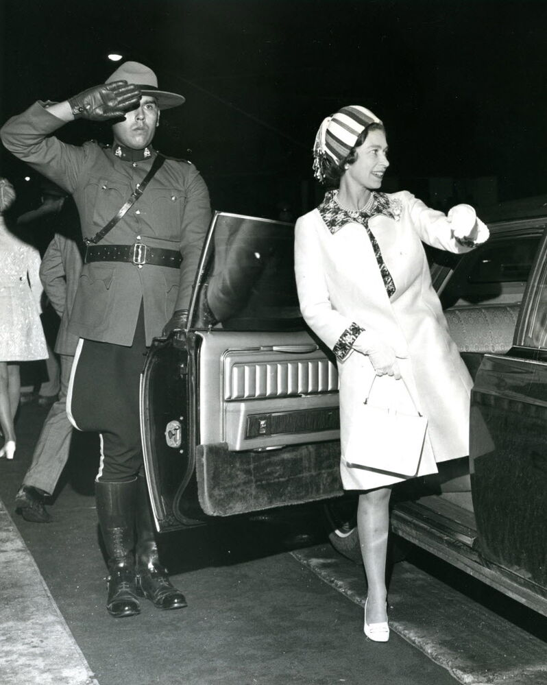 """The original caption on this 1970 photo was: """"An optical illusion - a one-legged Queen and a one-eyed RCMP officer."""""""