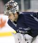 Pavelec spends extra time on the ice at Jets practice