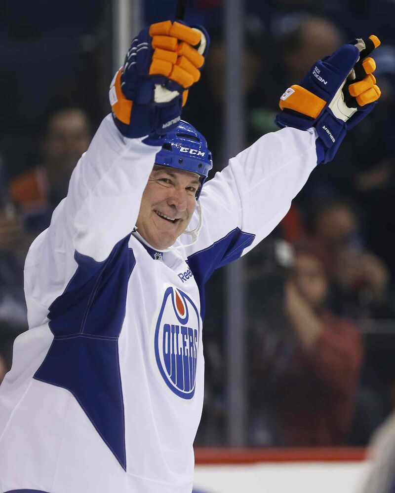 Former Edmonton Oilers Glenn Anderson celebrates his goal during a practice for the NHL's Heritage Classic Alumni game in Winnipeg. (JOHN WOODS / THE CANADIAN PRESS) - JOHN WOODS / THE CANADIAN PRESS