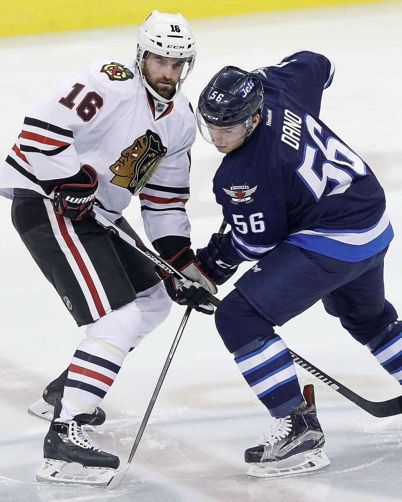 Andrew Ladd left, was traded by the Jets to the Chicago Blackhawks at the NHL trade deadline for young prospect Marko Dano, right, and a first round draft pick that would become Logan Stanley.