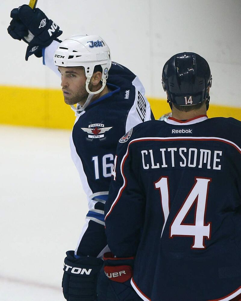 Winnipeg Jets  Andrew Ladd, left, celebrates his teammate Paul Postma's first NHL goal since the Jets returned to Winnipeg. (JOE BRYKSA / WINNIPEG FREE PRESS)