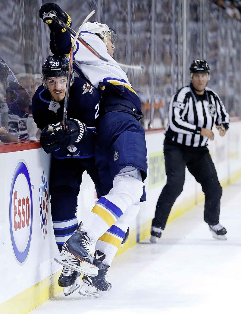 Winnipeg Jets' Jack Roslovic gets checked by St. Louis Blues' Jay Bouwmeester during their first-round playoff series. The Blues' size and physical style of play has served them well on their run to the Stanley Cup finals.