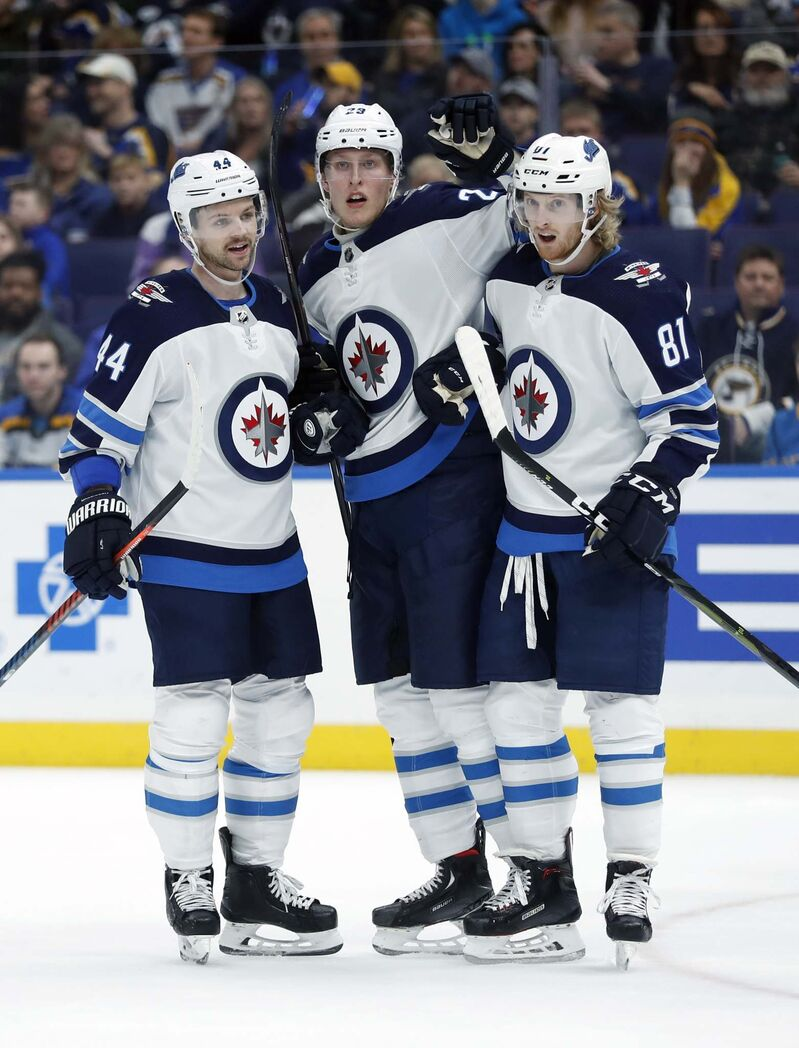 Patrik Laine, with Josh Morrissey (left) and Kyle Connor, is a goal shy of scoring 100 in his career. (Jeff Roberson / The Associated Press files)</p></p></p>