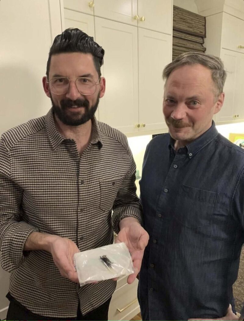 David Prichodko (left) was making a 50th birthday dinner for his partner, Alan Casey (right), when one of the creatures from a bag of mussels began to crawl. (Supplied)