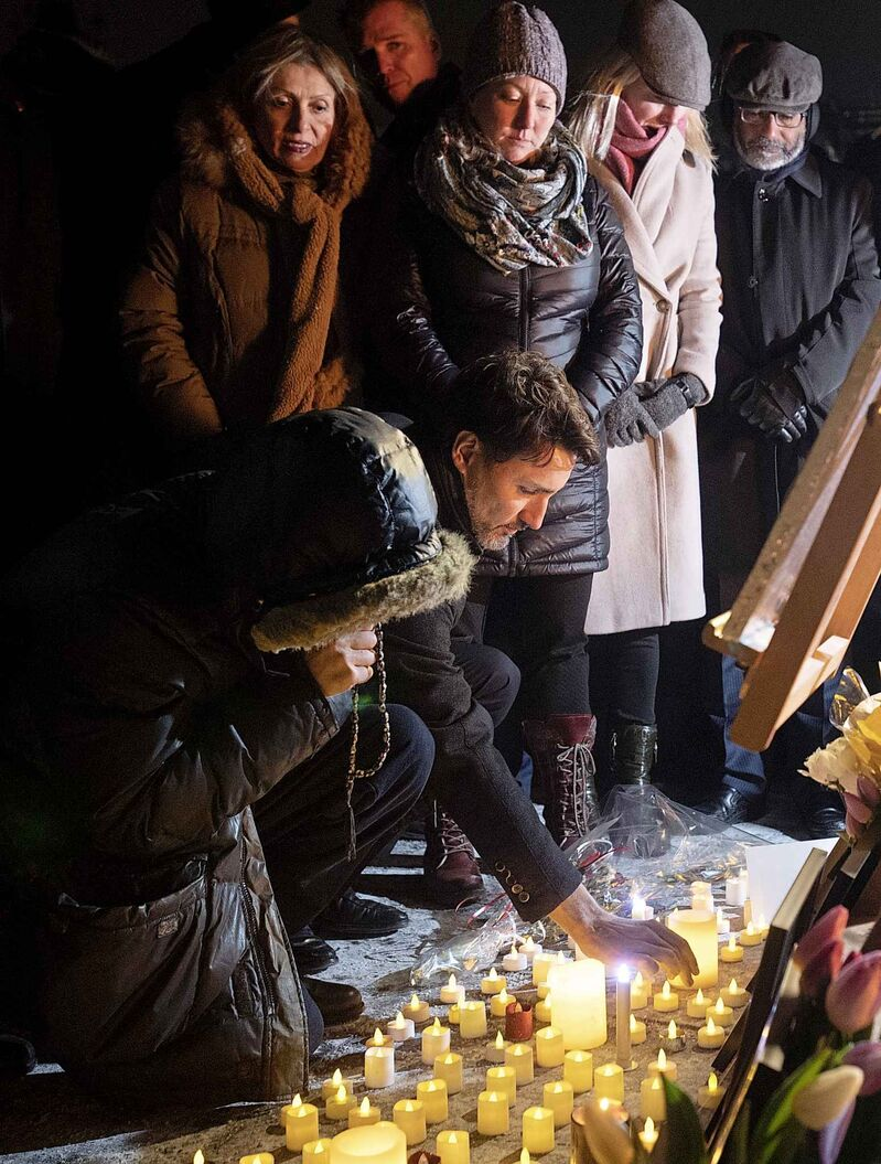 Prime Minister Justin Trudeau participates in a candlelight vigil to remember those killed on Ukraine International Airlines Flight on Thursday in Ottawa.