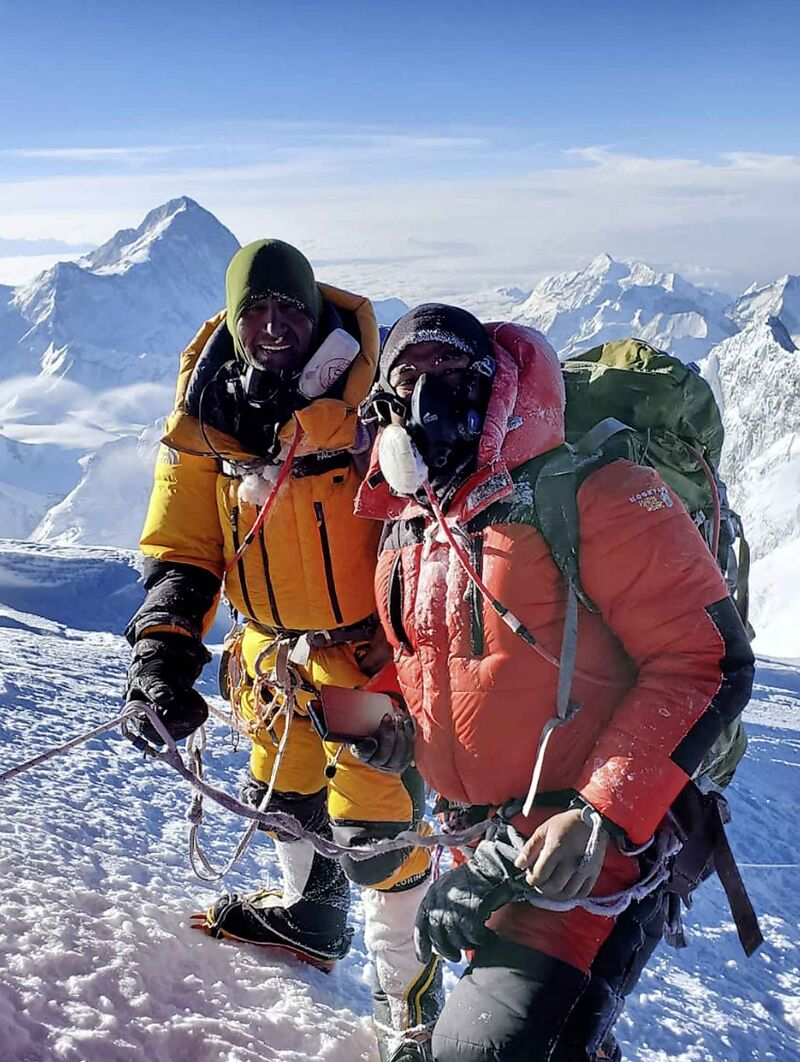 Shekhawat, left, with his sherpa Mingma Thindu Sherpa, at the summit of Everest. Shekhawat is a special education teacher at St. Amant who climbed the peak to raise money for the St. Amant Foundation.</p>