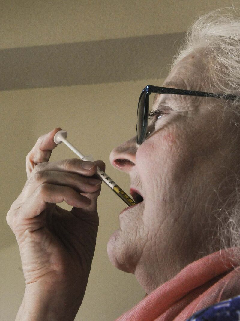 Sandi Krasowski / Winnipeg Free Press</p><p>McMillan self administers her dosage.</p></p>