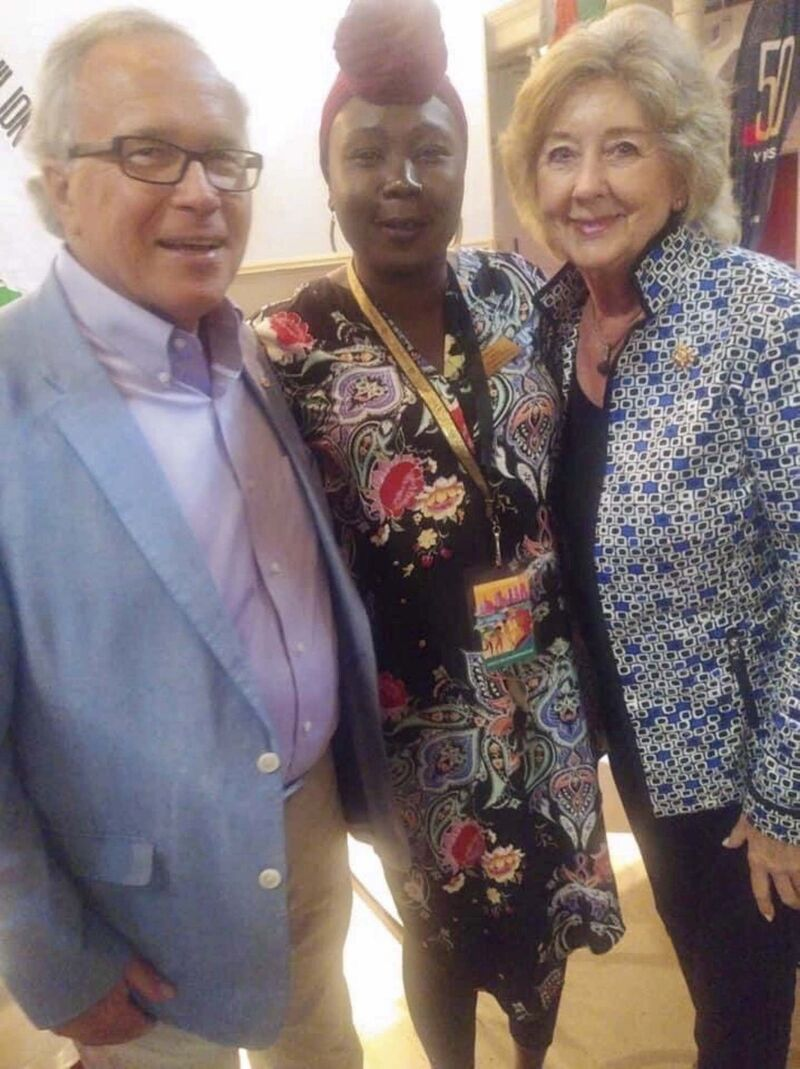 South Sudanese Pavilion co-ordinator Sandy Deng is seen with former Manitoba premier Gary Filmon and Manitoba Lt.-Gov. Janice Filmon at Folklorama in 2019.</p>