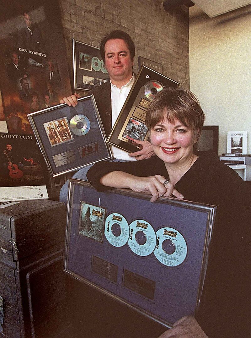 Carole Vivier with Kevin Walters in 1998, touting music and film productions their agencies were involved in.  (Wayne Glowacki / Winnipeg Free Press files)