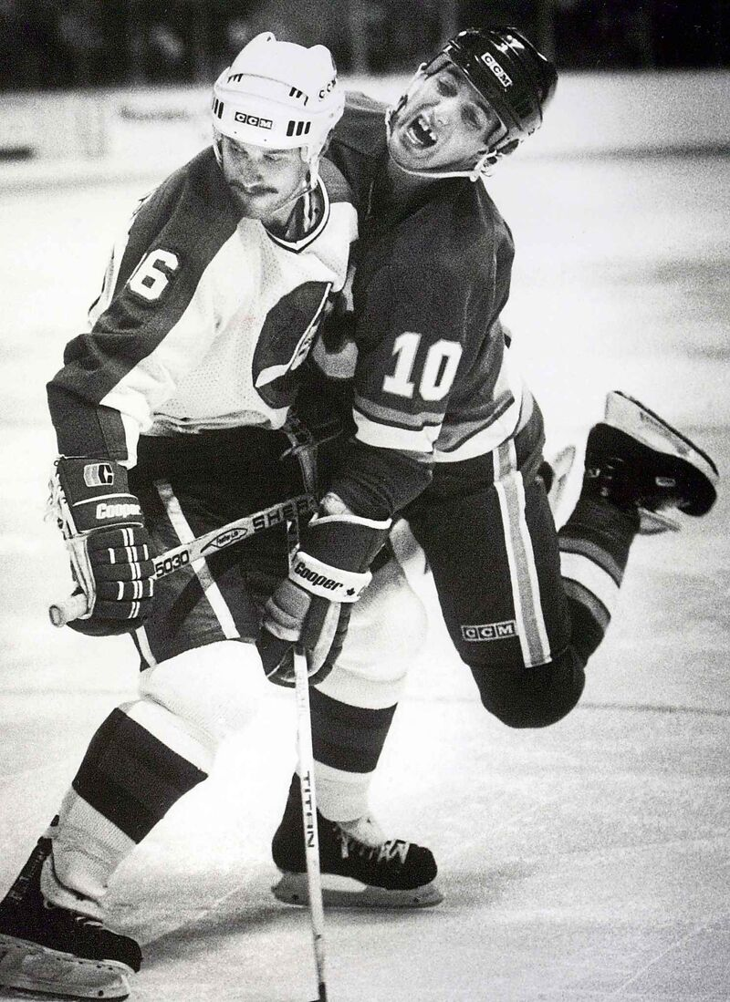 Winnipeg Jets' Laurie Boschman ties up his man in the faceoff circle during a game against the Calgary Flames in the 80s.