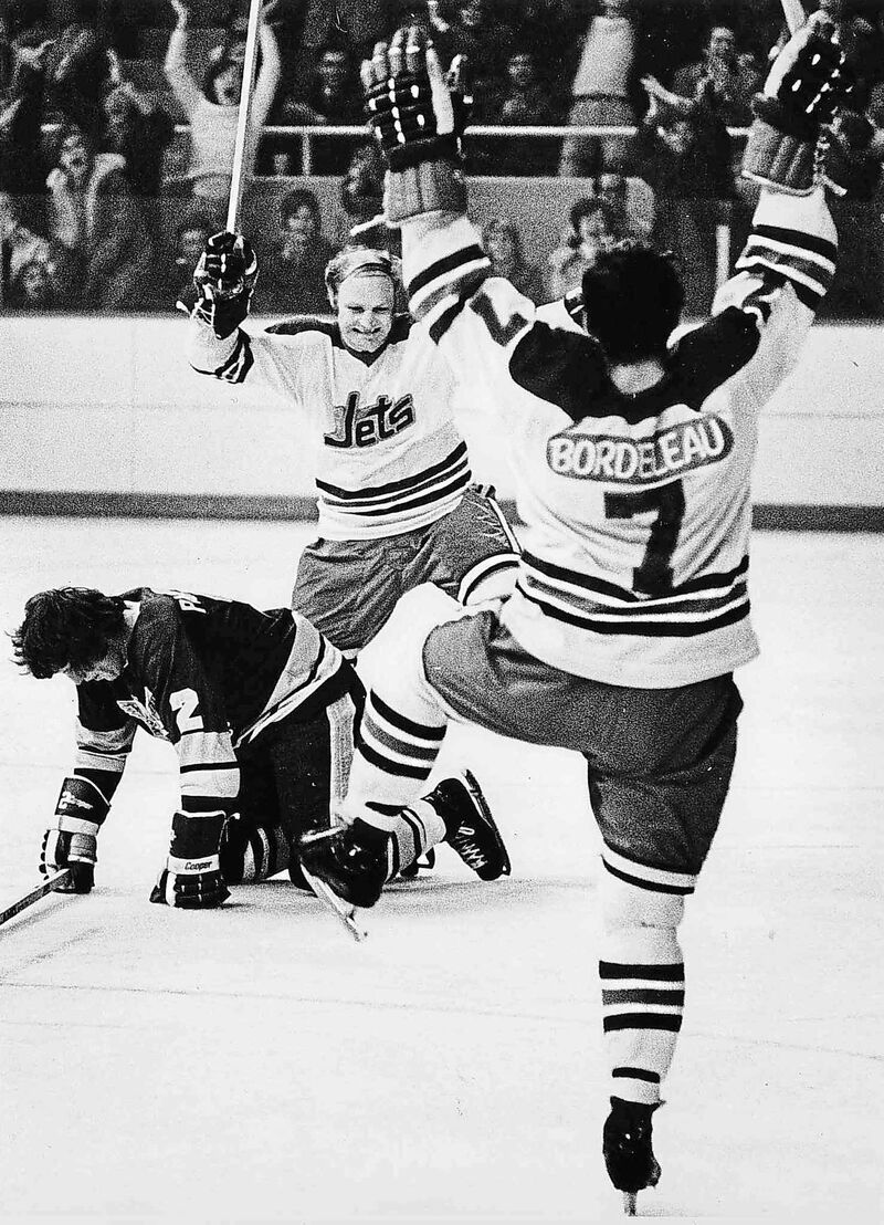 Bobby Hull celebrates a goal with Jets team mate Chris Bordeleau in the WHA.
