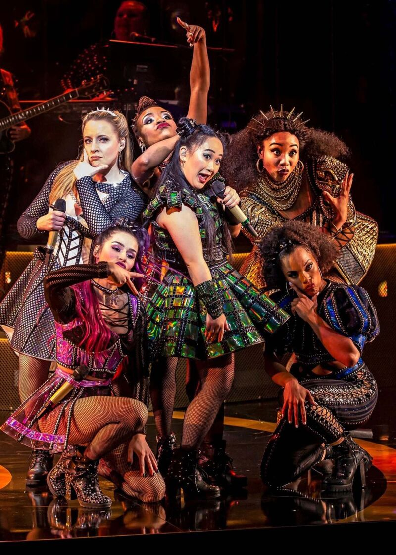 Six is a pop-infused history of the six wives of Henry VIII staged along the lines of a pop-singing competition featuring an all-female cast and an all-female band. (Supplied)