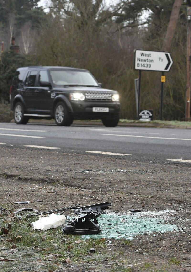 Broken glass and car parts on the road side near the Sandringham Estate, England, where Prince Philip was involved in an accident in January.