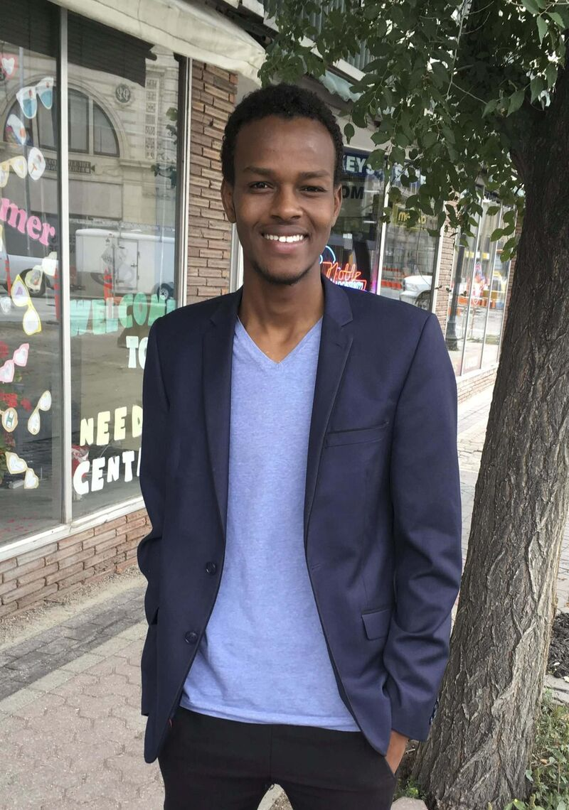 Aden Mohamed won a scholarship from Gordon Bell High School and will be studying math and science at the University of Winnipeg while working in retail to help support his family in Canada and back in an African refugee camp. (Carol Sanders / Winnipeg Free Press) </p>