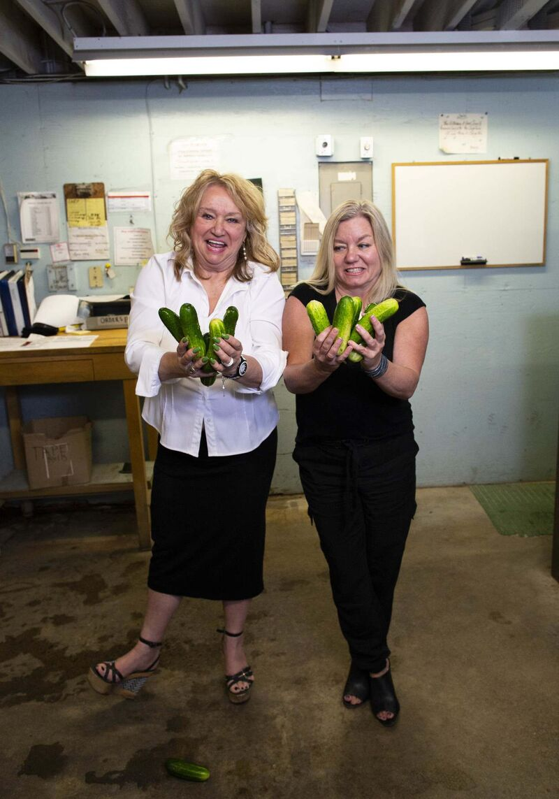 Millie Krause, left, and her daughter Payton Krause with their pickles at Elman's Food Products on Jarvis Avenue. (Photos by Andrew Ryan / Winnipeg Free Press)