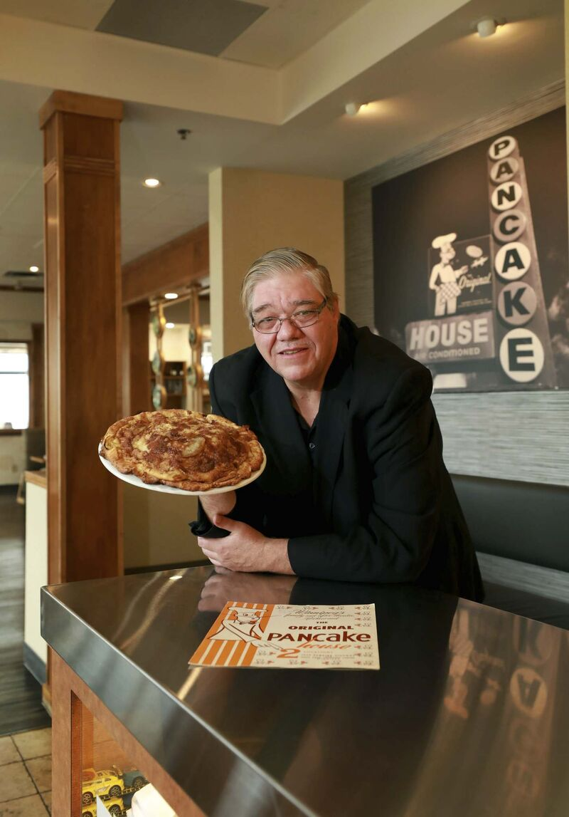 General manager Robert Walker with the restaurant's Giant Apple Pancake. 'We're continually trying to come up with new recipes.'</p>