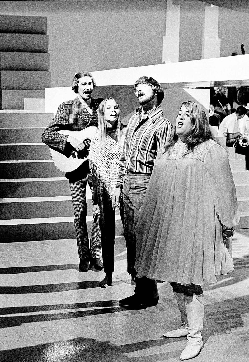 The Mamas and the Papas perform onstage, on August 20, 1966, in Los Angeles, California. From left are :John Phillips, his wife Michelle Phillips, Dennis Doherty and Cass Elliott.
