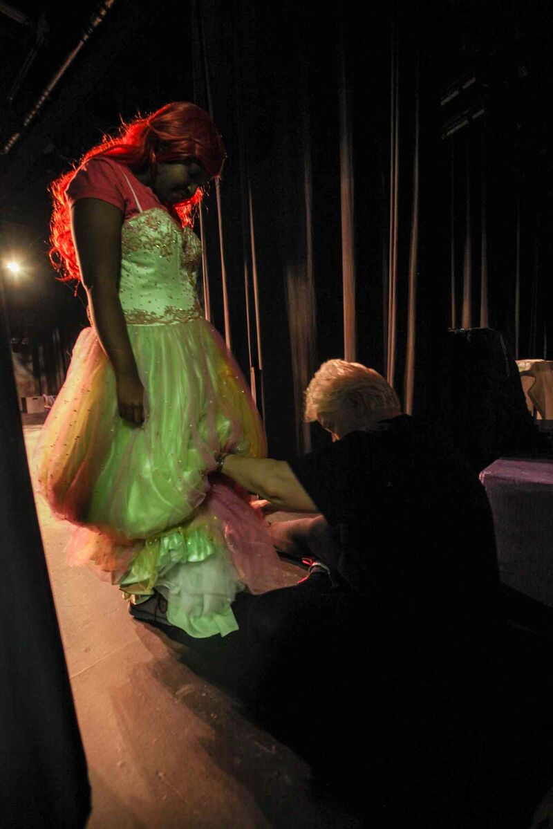 An educational assistant helps a student get into her costume before the start of The Little Mermaid.  (Mike Deal / Winnipeg Free Press)