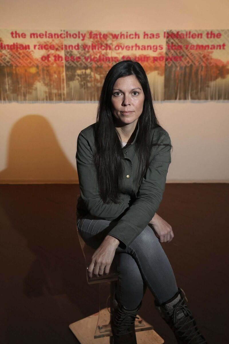 Artist Sarah Sense's exhibition at Urban Shaman gallery  uses traditional Chitimacha weaving techniques on strips of photographs and text. (Ruth Bonneville / Winnipeg Free Press)