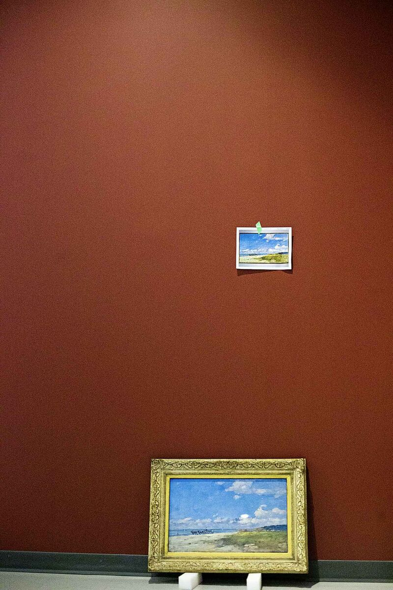 A photograph of a painting marks the spot where the original work will hang.