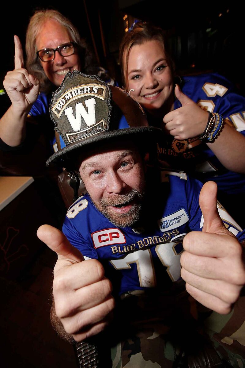 Claudia Byczek (from left), Dan LeBlanc, aka Lt Dan, and Fraser Olson left for Calgary on Tuesday to support the Winnipeg Blue Bombers in the Grey Cup. (John Woods / Winnipeg Free Press)
