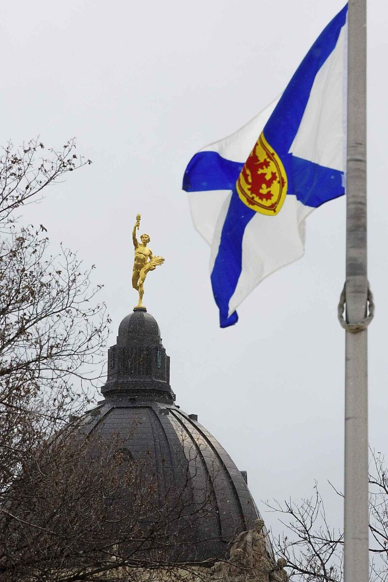 The Nova Scotia provincial flag flies at Memorial Park across the street from the Manitoba Legislative Building Monday in support of the victims of the massacre. (Mike Deal / Winnipeg Free Press)