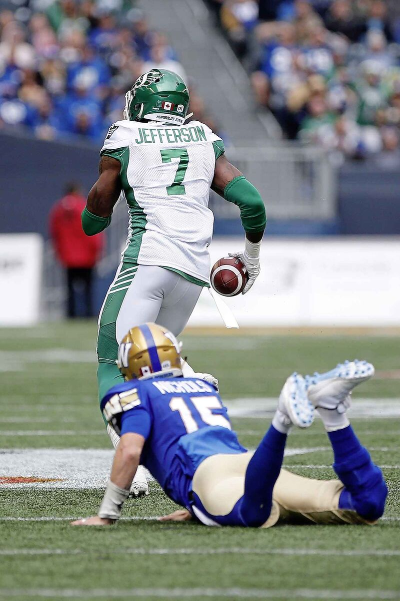 Winnipeg Blue Bombers quarterback Matt Nichols watches as Saskatchewan Roughriders' Willie Jefferson runs for a touchdown after intercepting Nichols' pass during the first half of the Banjo Bowl in September.