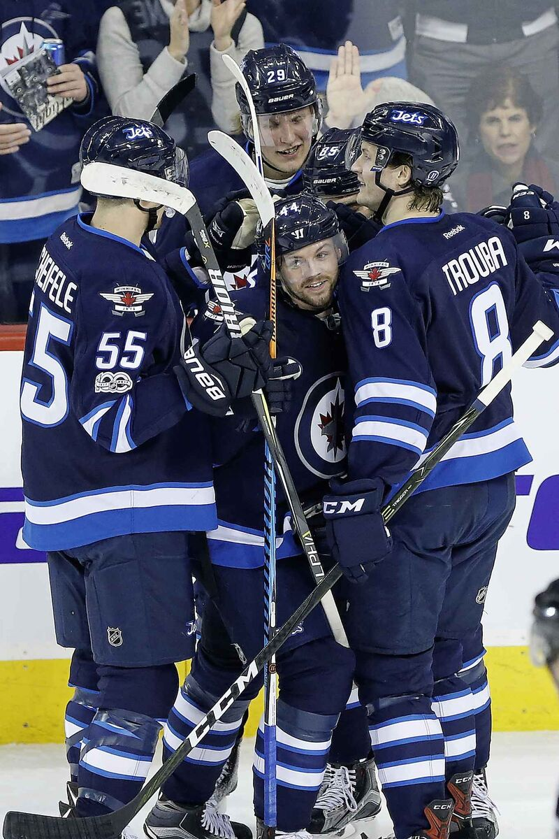 Winnipeg Jets' Mark Scheifele (55), Patrik Laine (29) and Jacob Trouba (8) and Josh Morrissey (44) are part of a young Jets core that is the envy of the league.