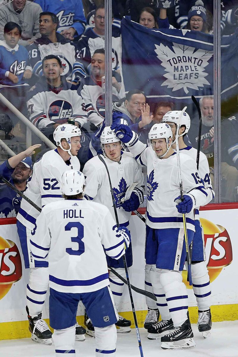 Toronto Maple Leafs players celebrate a goal against the Winnipeg Jets on Thursday. Leafs fans in attendance had plenty to cheer for during the Leafs' 6-3 win at Bell MTS Place.