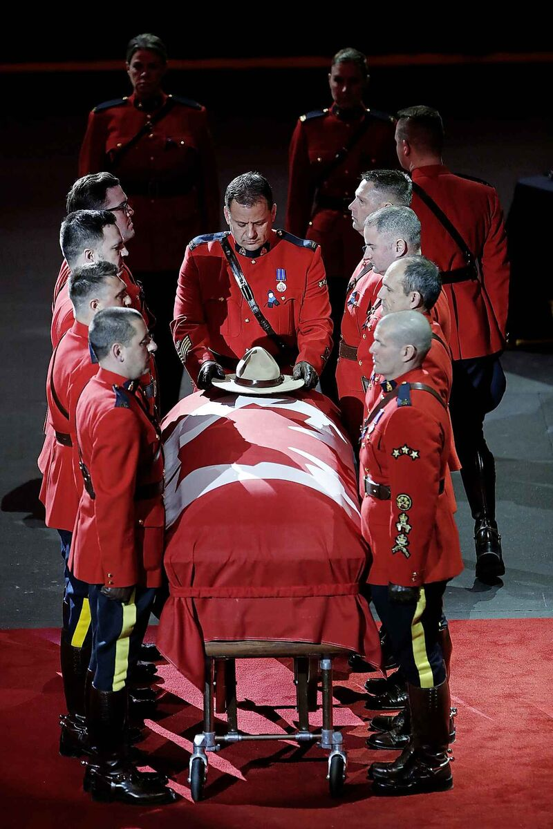 A Stetson is placed on the casket. (John Woods / The Canadian Press)