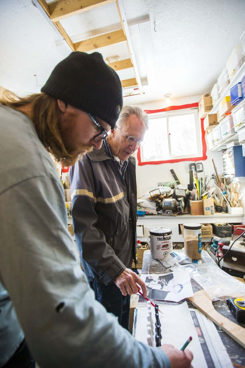 Simmons and his son, Will, work on rebuilding his props in his workshop. (Mikaela MacKenzie / Winnipeg Free Press)</p>
