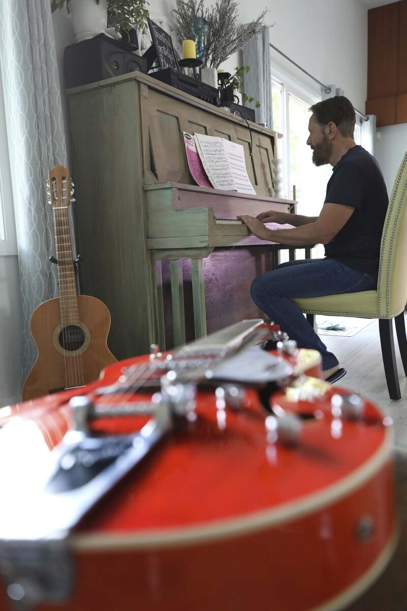 Chris Burke-Gaffney tickles the ivories at his Winnipeg home.